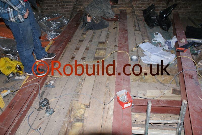 loft conversion metal beams RSJ support flooring