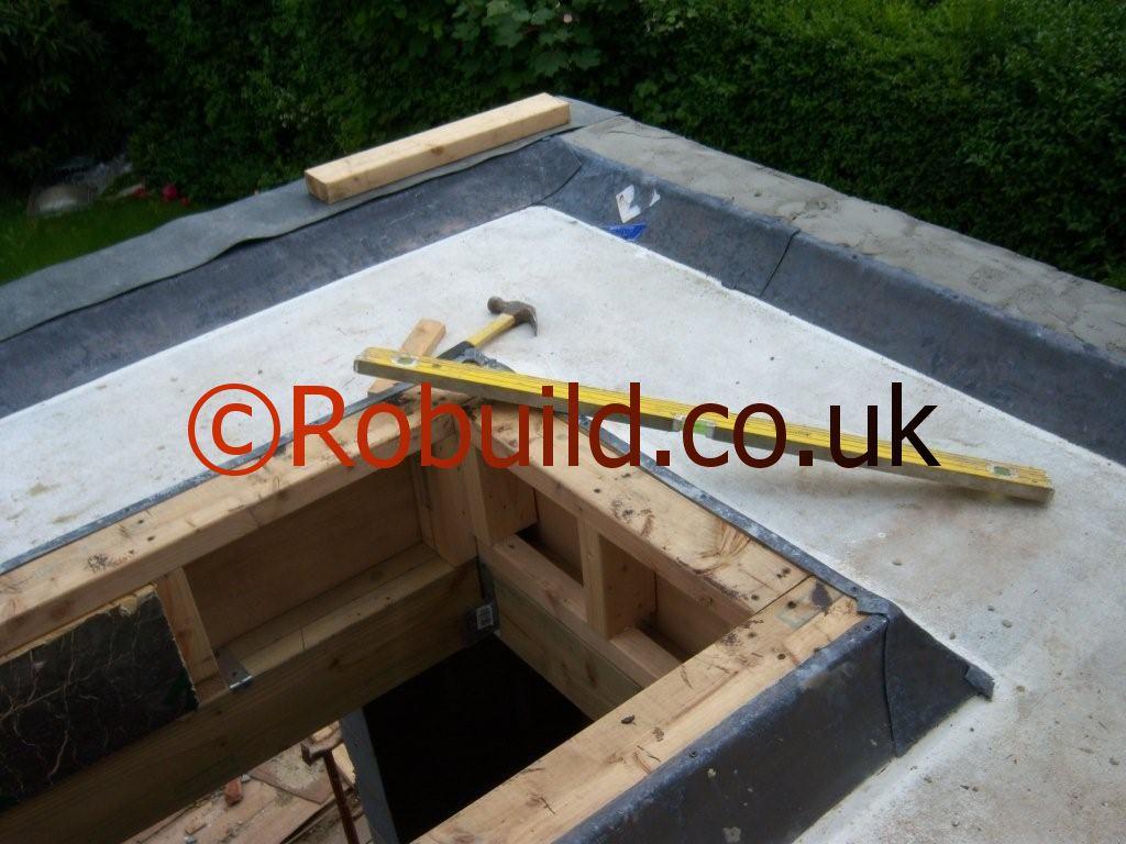 Asphalt Flat Roof Window Installation