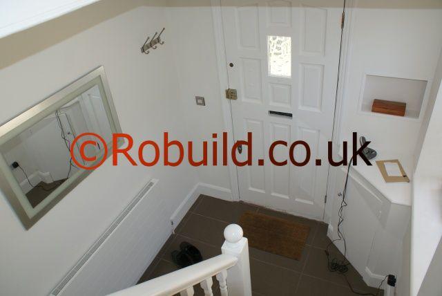 hallway staircase mirror cupboard