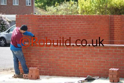 bricklayer building a brickwall