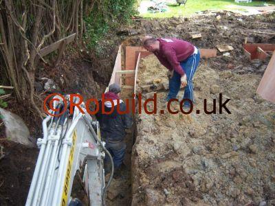 Mechanical digger digging foundation
