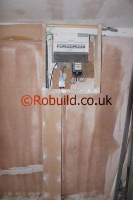 garage conversion consumer unit fuse box plastering