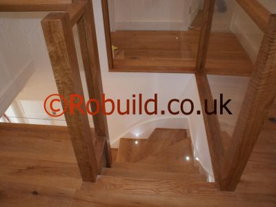 glass balustrade hardwood staircase